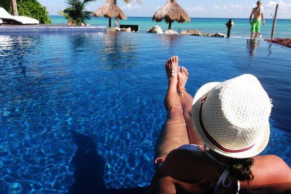 Relaxing in the infinity pool in moments of zen wearing Chelsea Bond Jewelry.