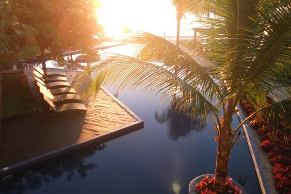 Sunset, poolside.