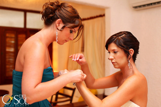 Sweet moments between Dawn and her Maid of Honor of putting on her wedding bracelet.