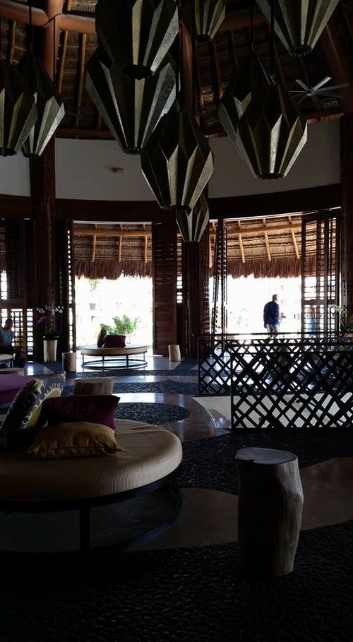 Circular seating and Moroccan lanterns fill the open air lobby.