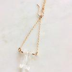 gold and rock quartz necklace