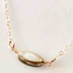 shell and gold necklaces by chelsea bond