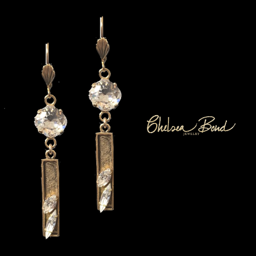 long gold earrings with crystals